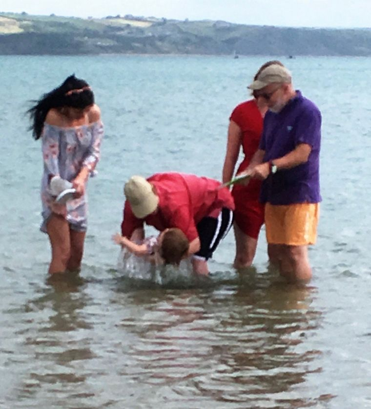 Making a splash: Methodist minister baptises 16-month-old toddler in the sea